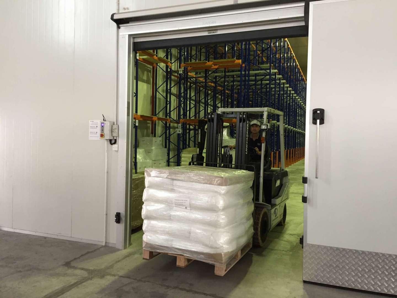 forklift sending stocks to warehouse storage