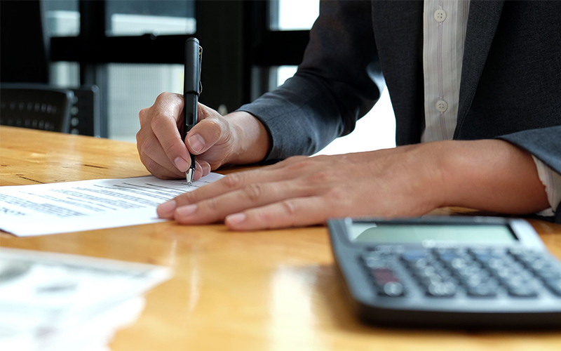 man signing forwarding and customs clearance forms